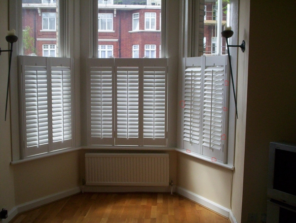 Contemporary plantation shutters for sunshine bay window.