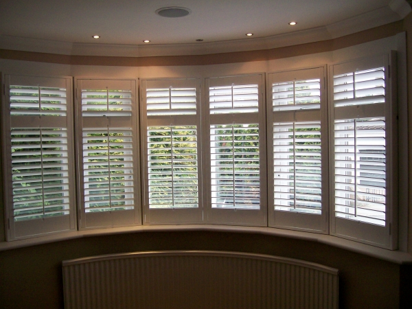 Curved Bay Window Shutters Painted Neutral Colours In