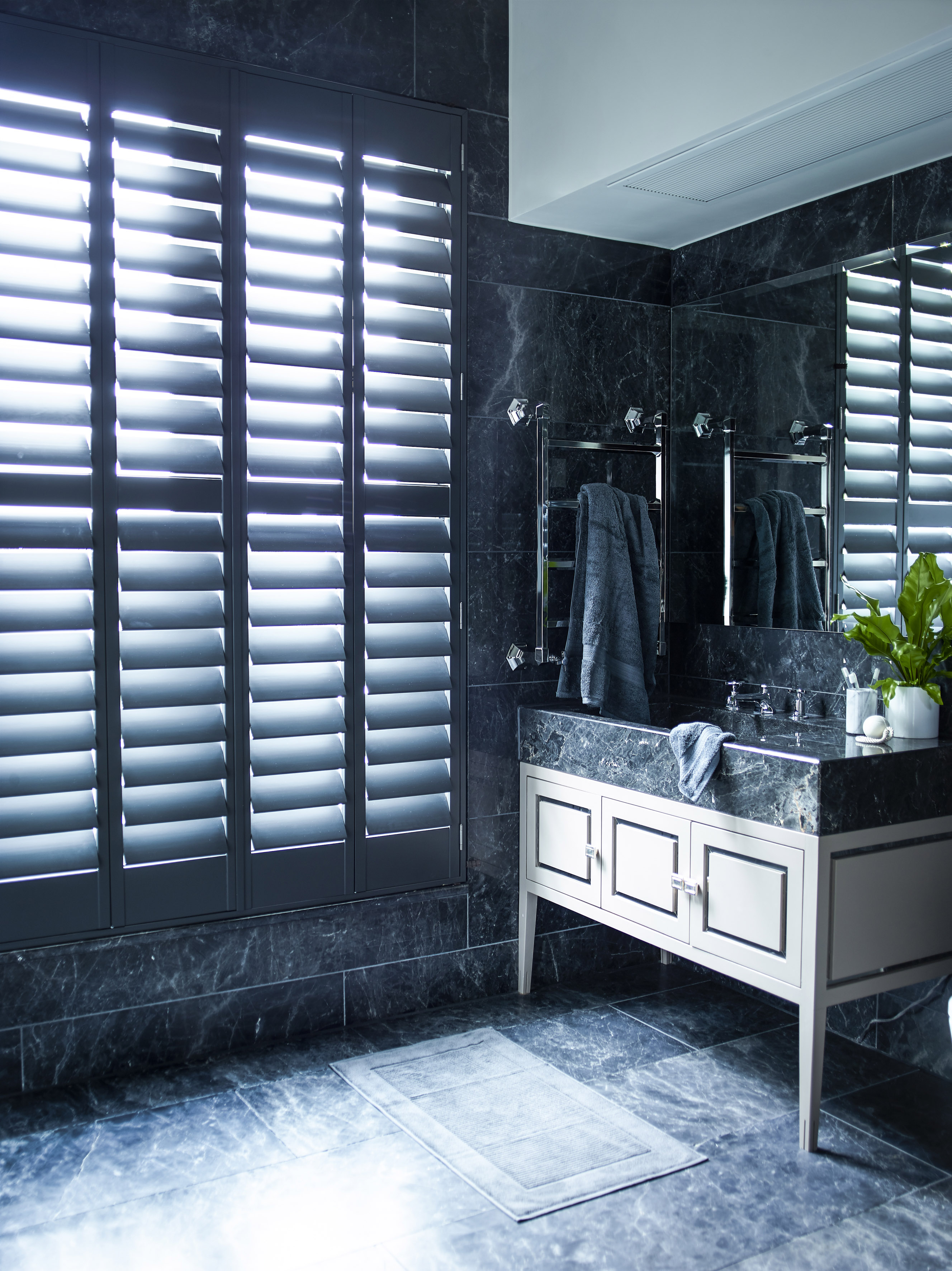 black bathroom with black shutters