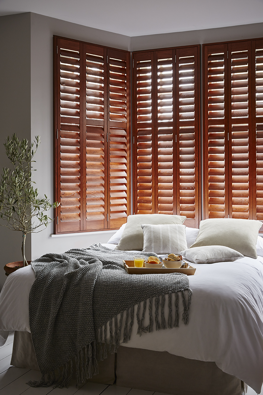 wooden shutters in bedroom