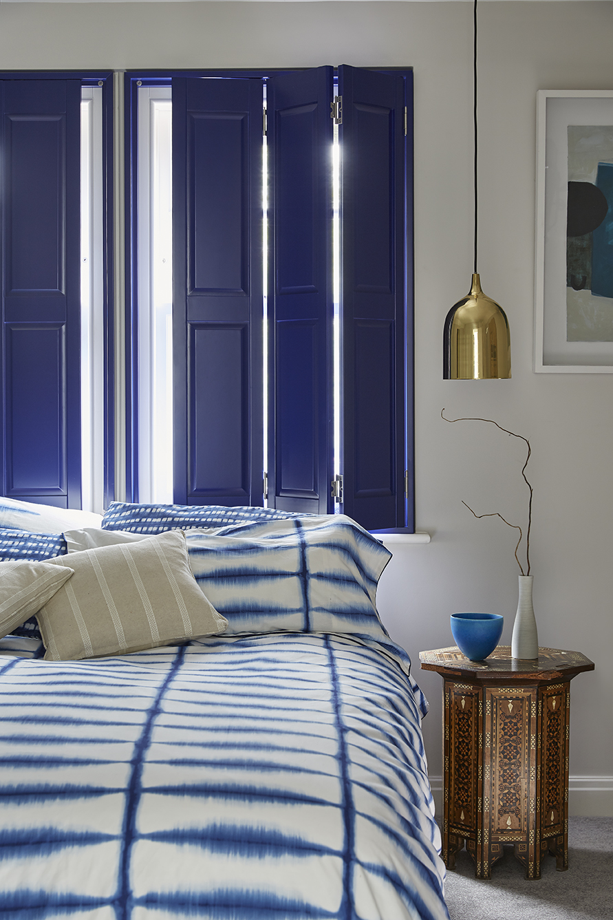 Royal blue solid shutters in bedroom by Shutterly Fabulous