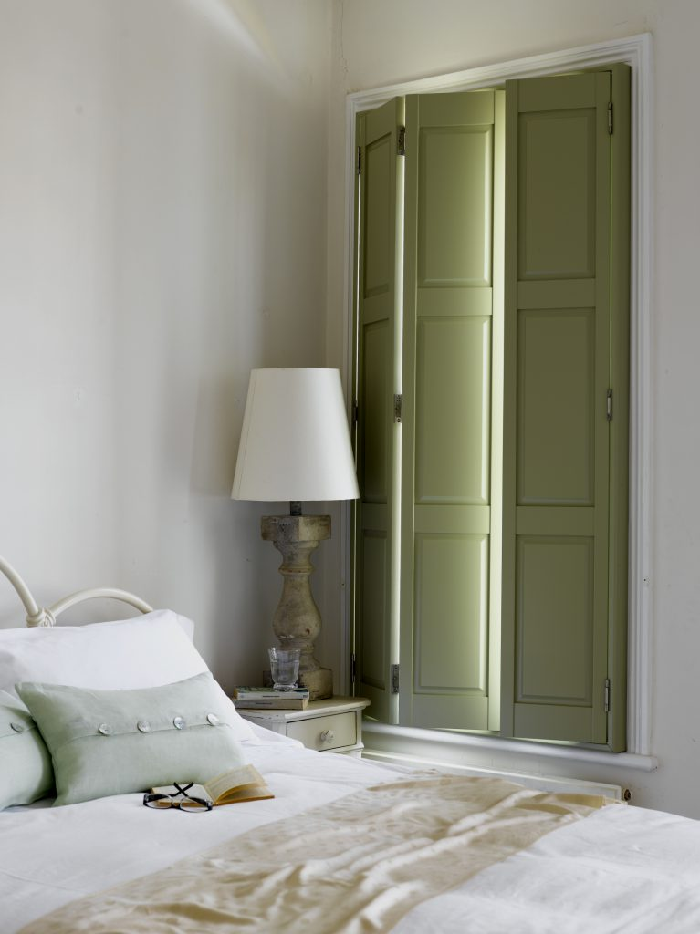green full height shutters in bedroom
