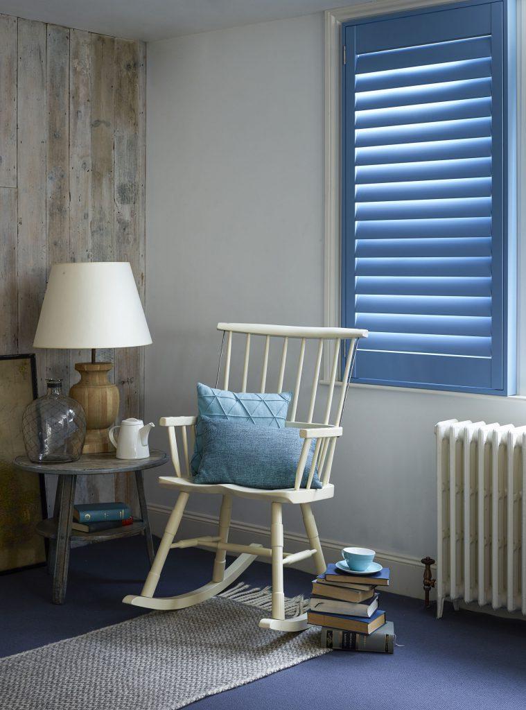 Custom blue full height shutters for the living room
