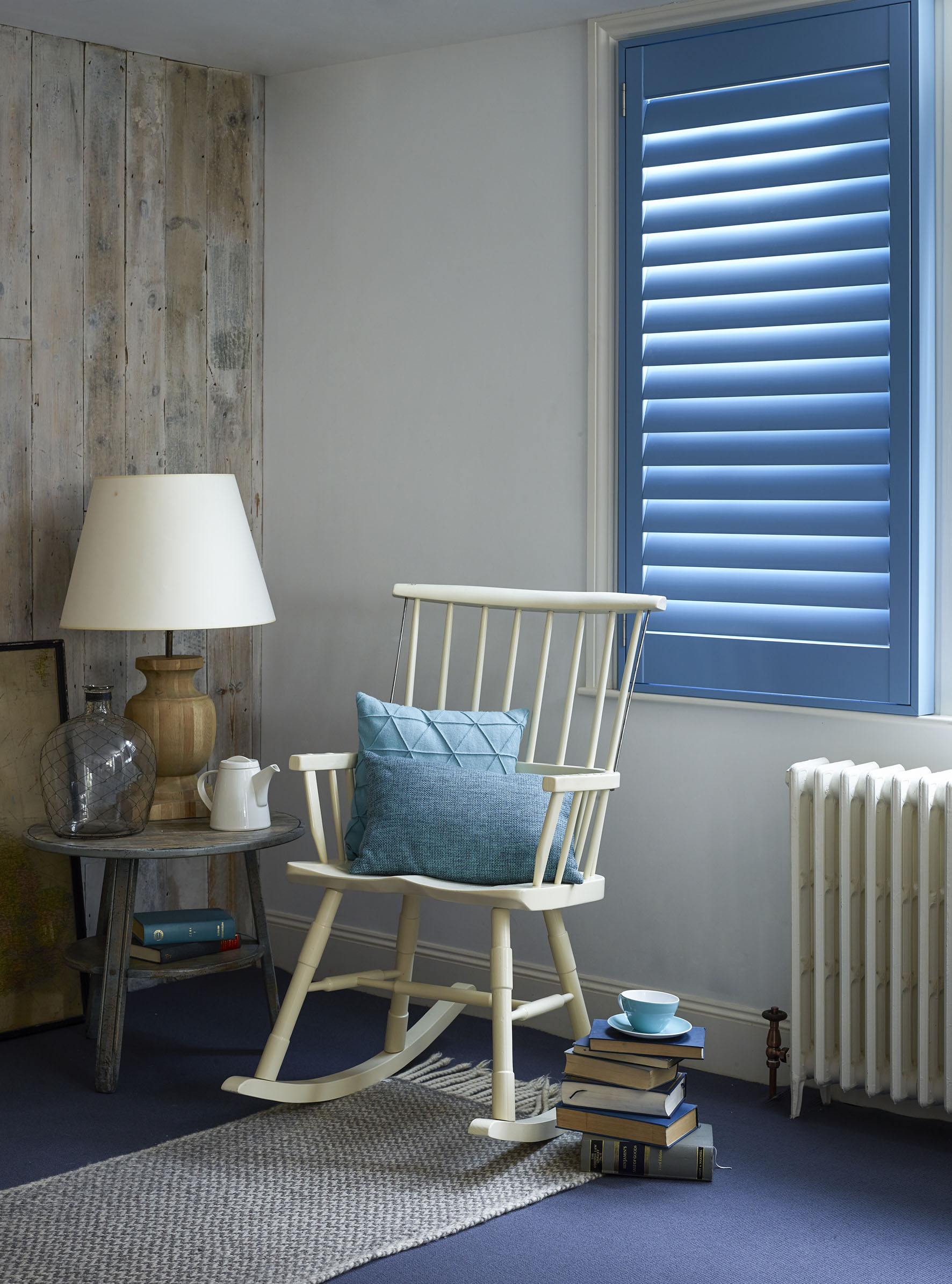 Custom blue full height shutters for the living room