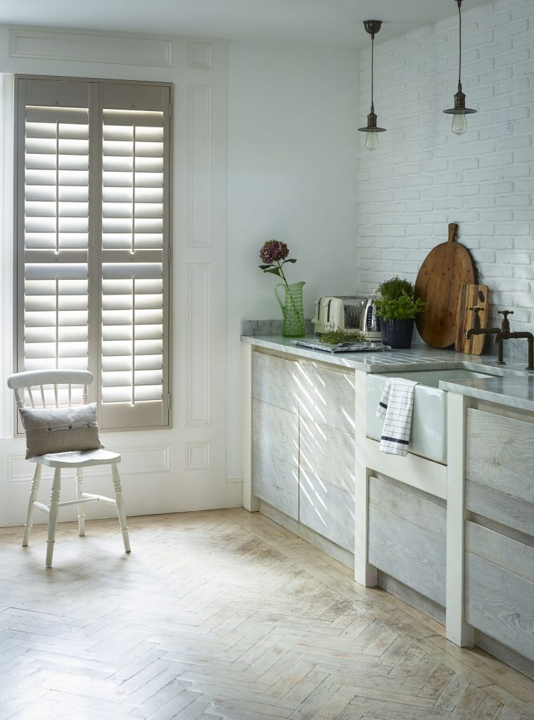 Dove full height shutters in modern kitchen
