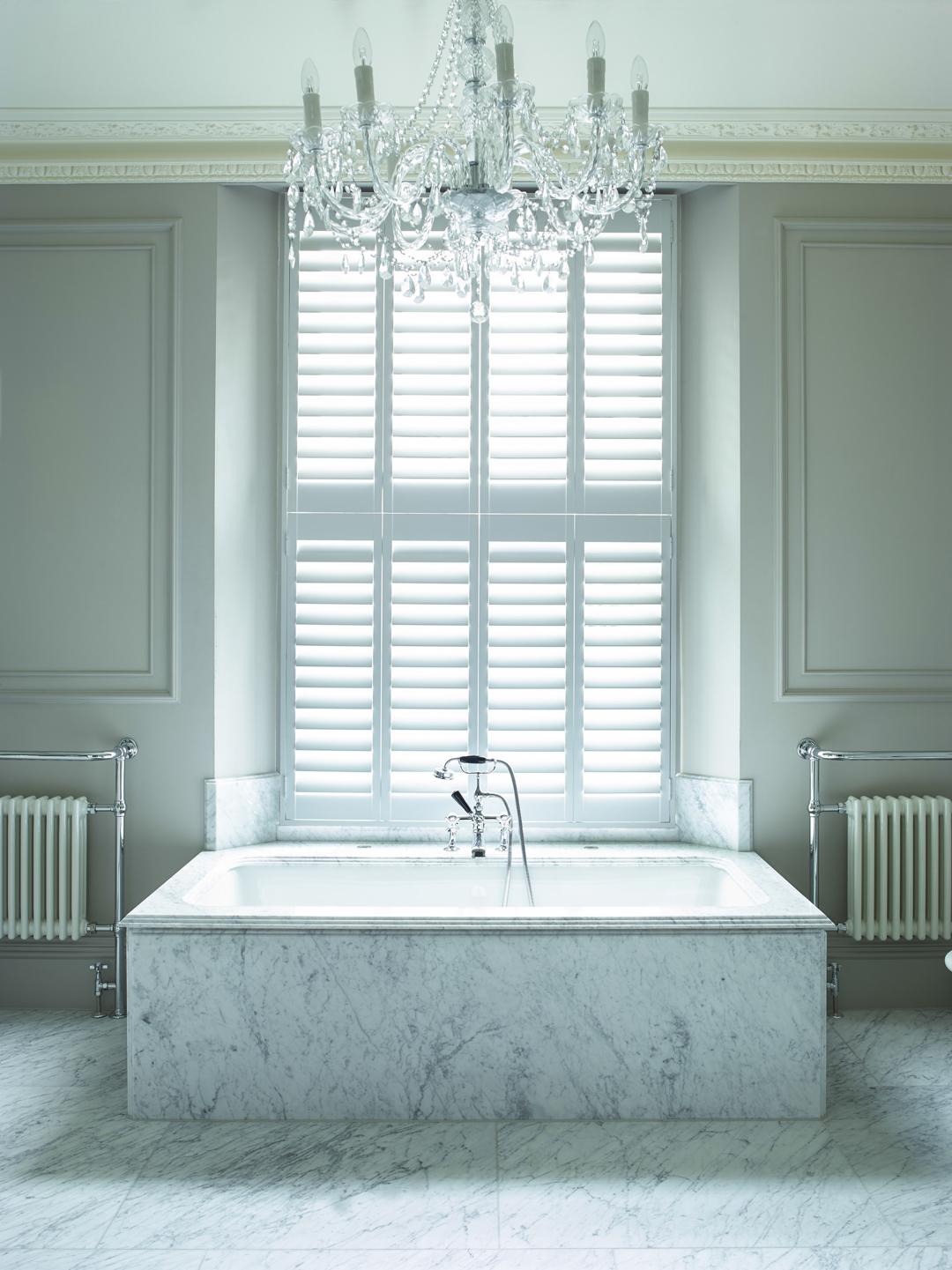 white shutters in white bathroom by Shutterly Fabulous