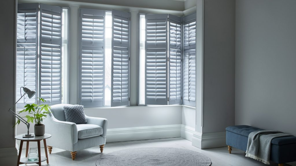 Custom grey full height shutters for the living room