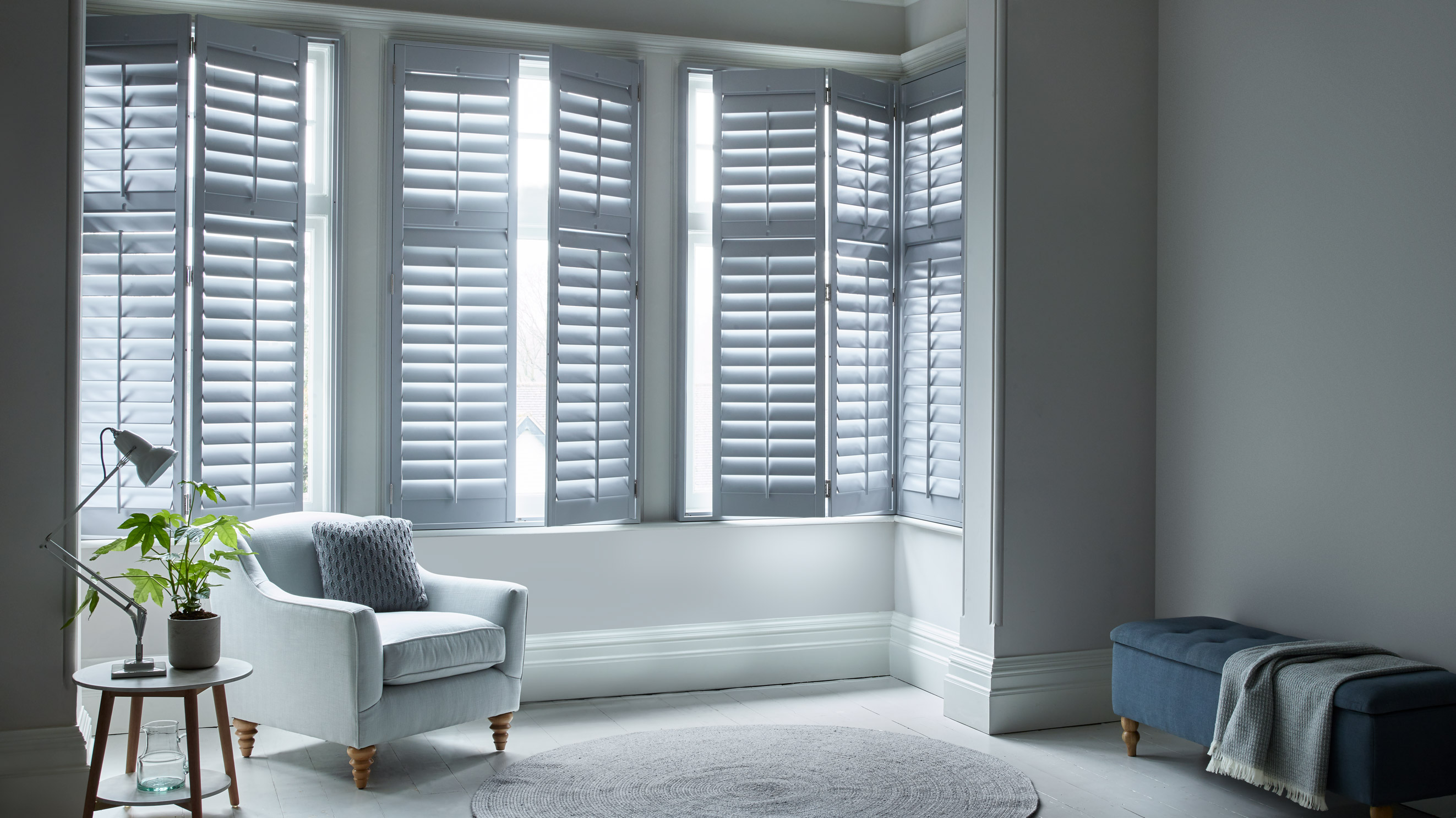 Custom grey full height shutters for the living room