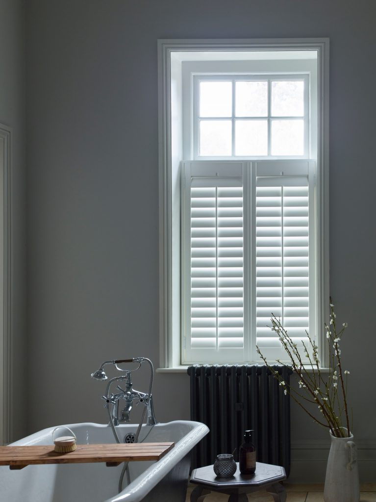 white cafe style shutters in bathroom