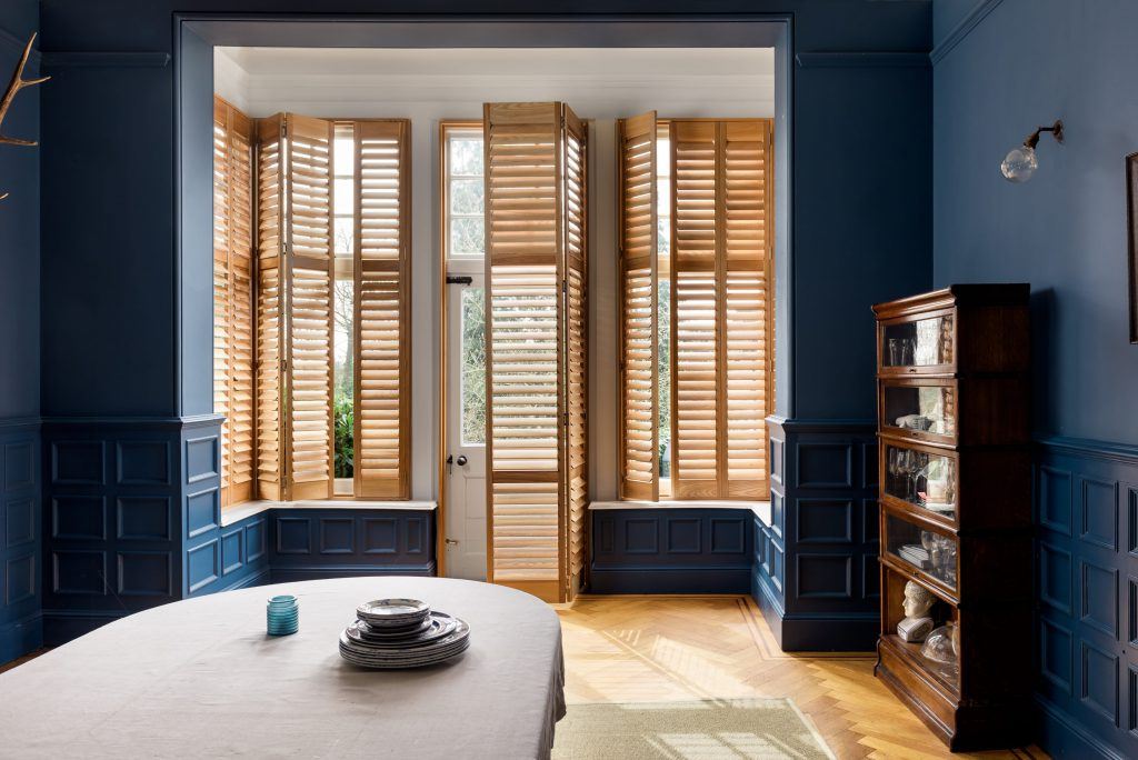 Wood against blue dramatic shutters by Shutterly Fabulous