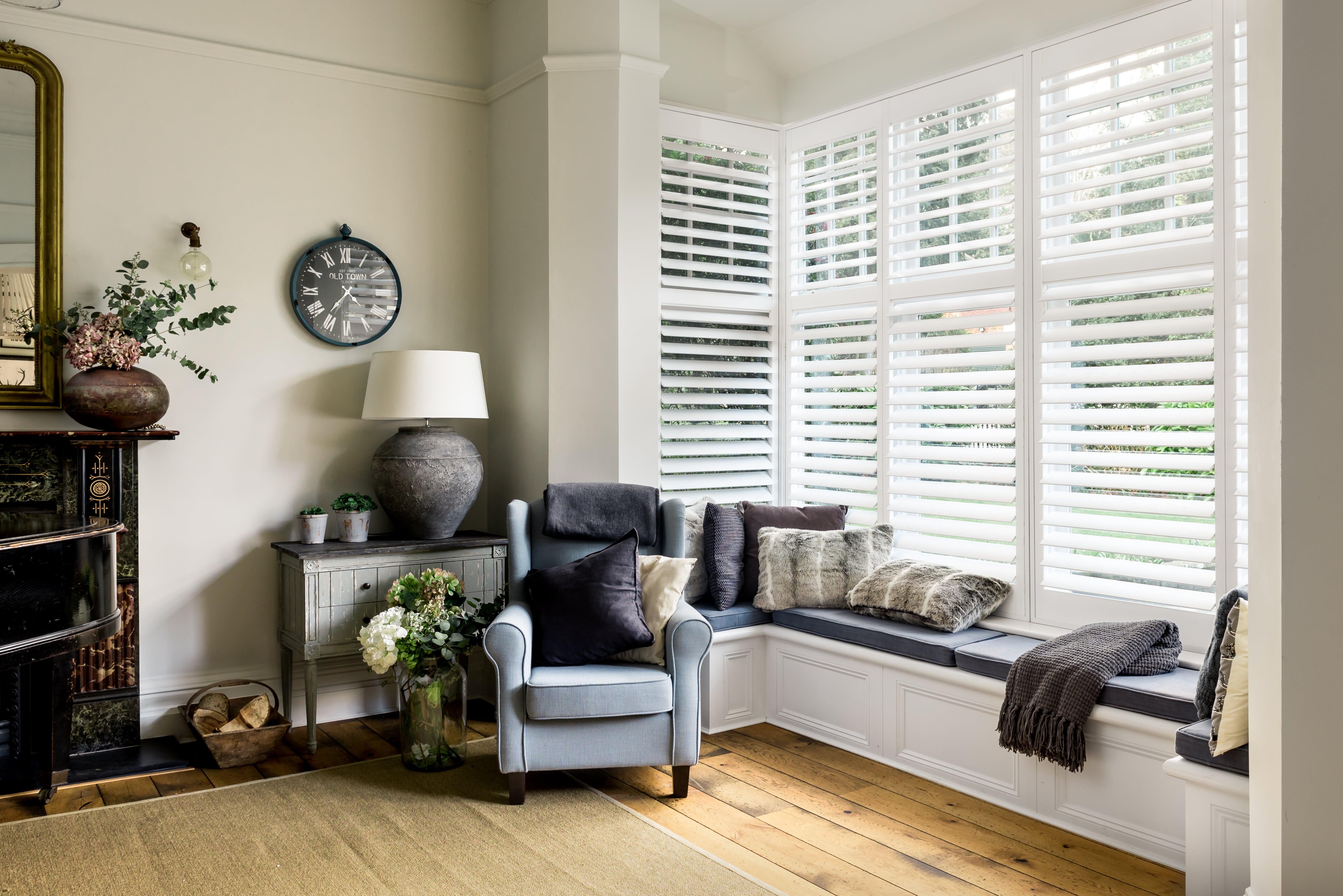 Window seat shutters in soft white