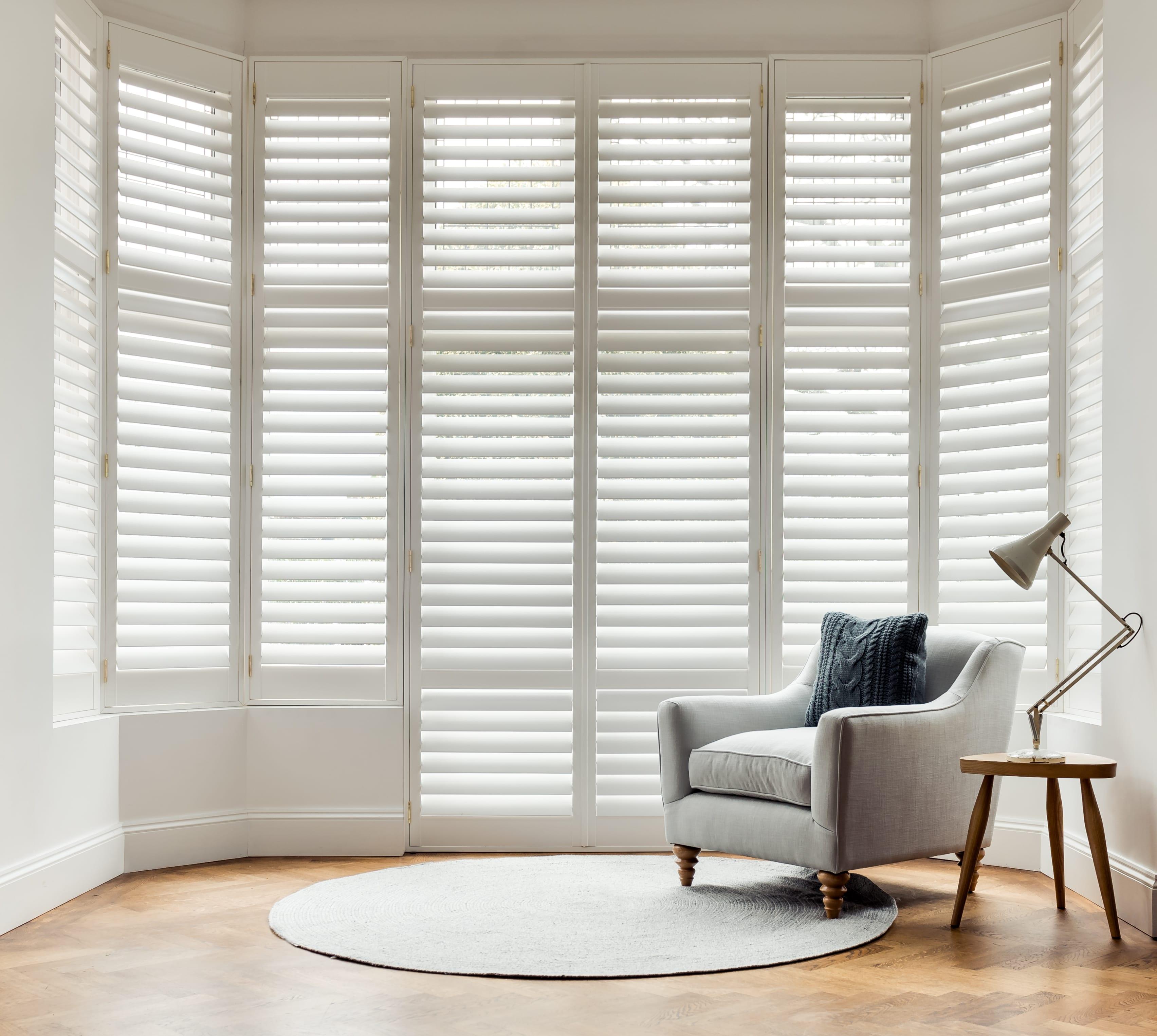White full height shutters in the living room