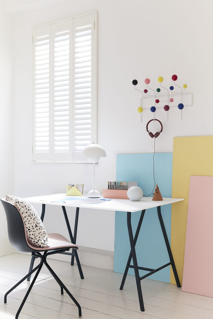 Painted wooden shutters for an office