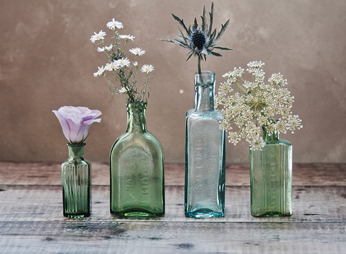 Rustic bottles with flowers