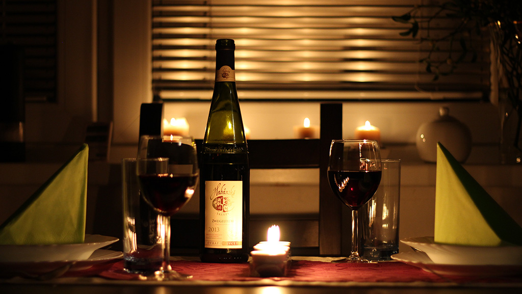 Candles and a bottle of wine