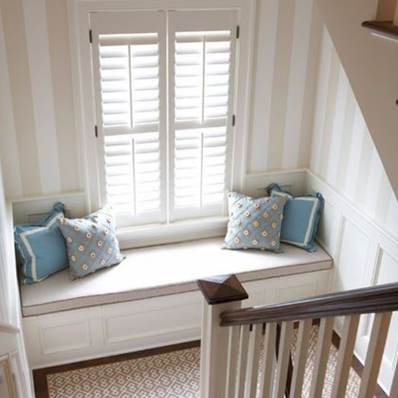 Full height shutters in window seat by Shutterly Fabulous