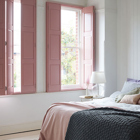 adobe pink solid panel shutters in bedrooom