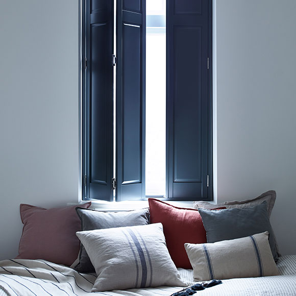blue solid shutters in bedroom