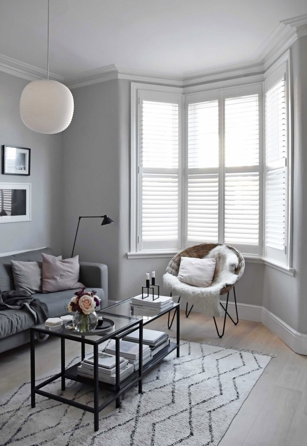 Plantation shutters for living room by Shutterly Fabulous