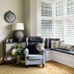 white living room shutters in living room with window seat