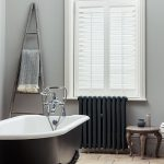 Bathroom shutters in white with modern decor