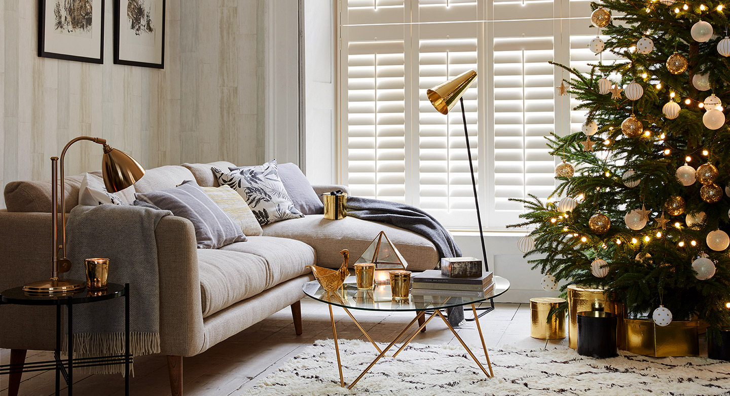 Bay Window White Living room shutters decorated with gold and white christmas décor