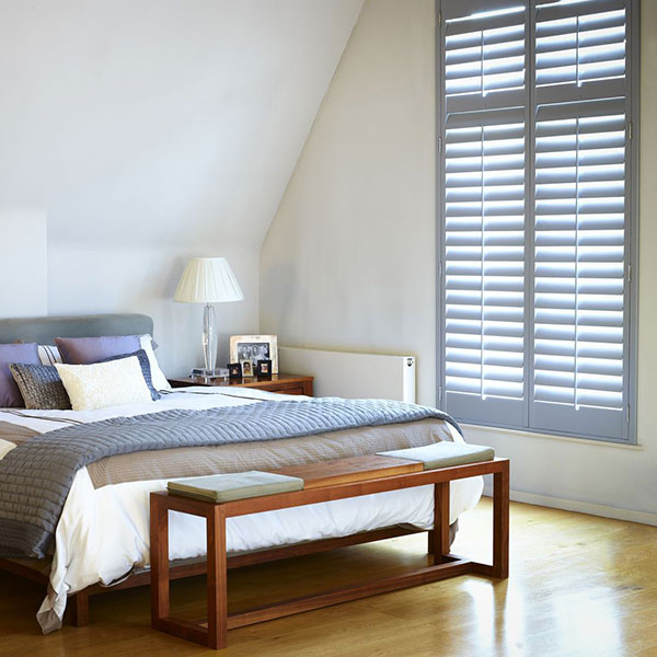 grey shutters in bedroom window by Shutterly Fabulous