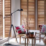 natural wood shutters with modern living room design