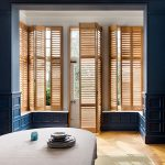 natural wooden shutters in blue walls by Shutterly Fabulous