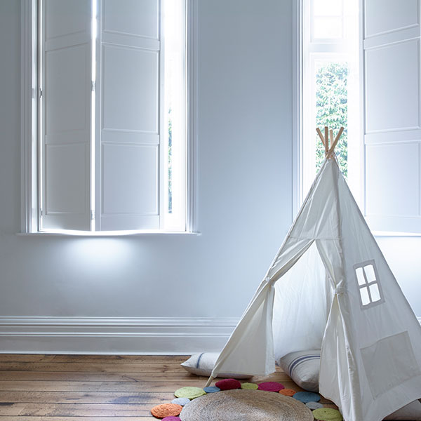 white solid panel shutters in kids room