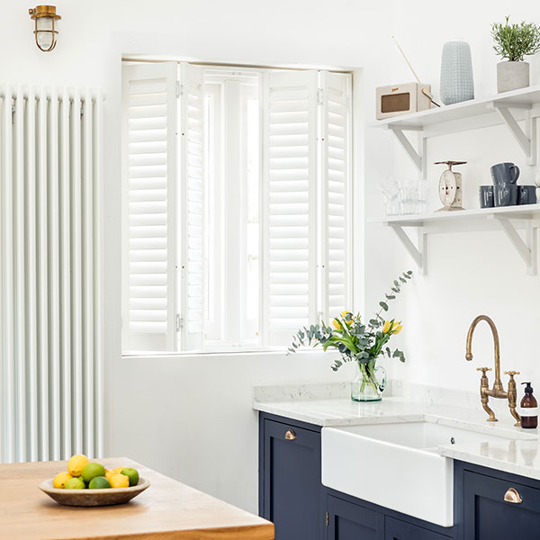 Modern kitchen decor with white shutters by Shutterly Fabulous